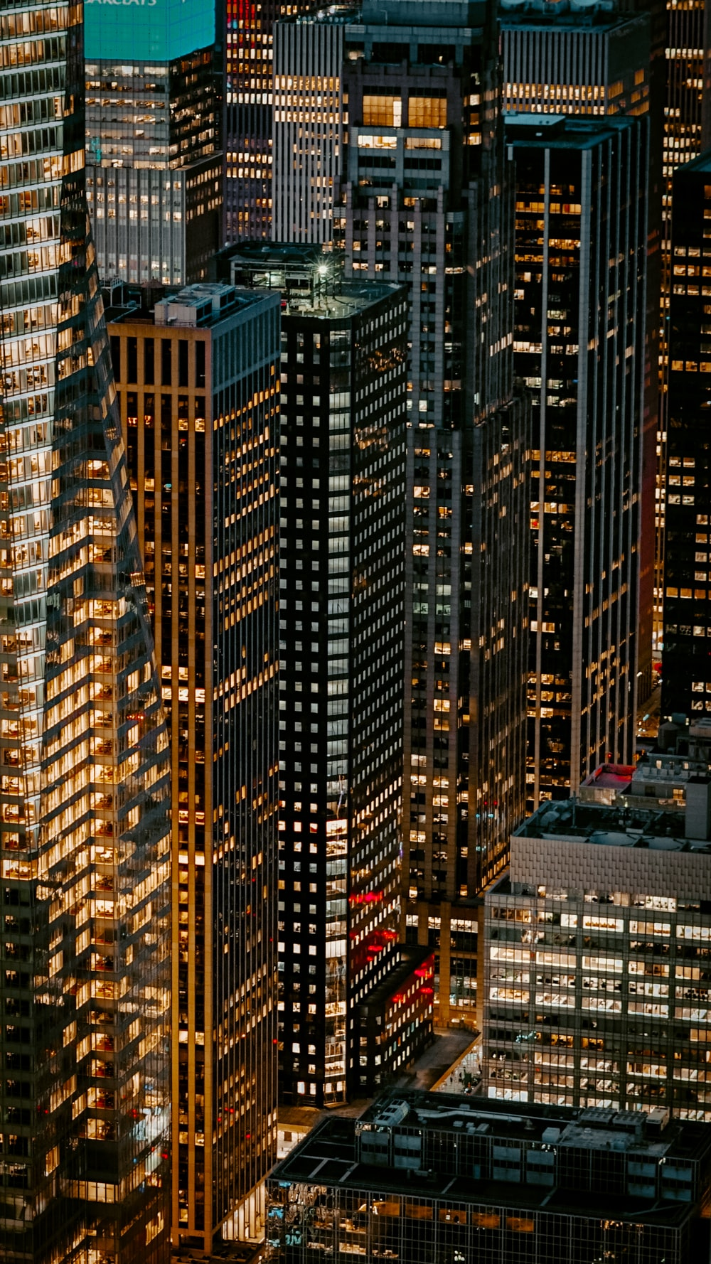 turned-on lights of high-rise building