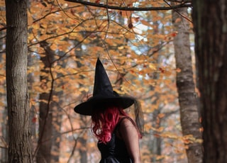 witch standing under trees