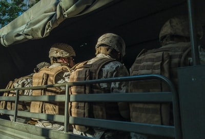 soldiers in truck military zoom background