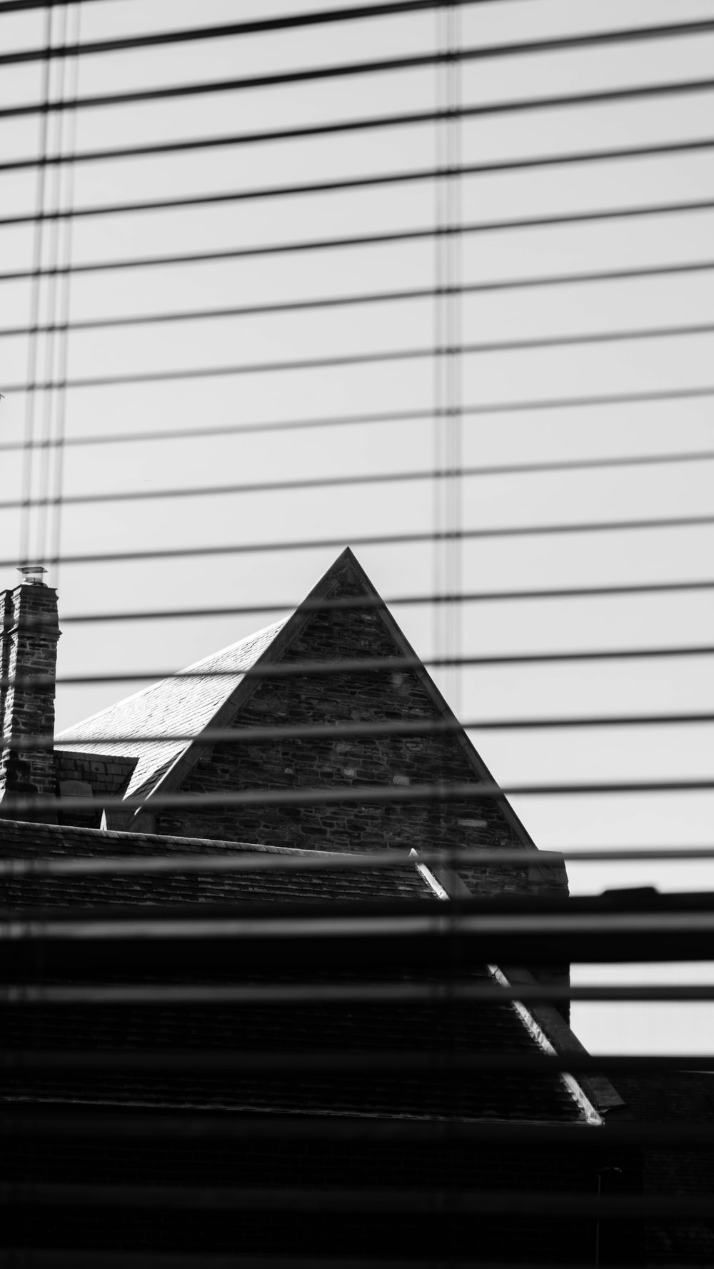 silhouette of house behind of window blinds