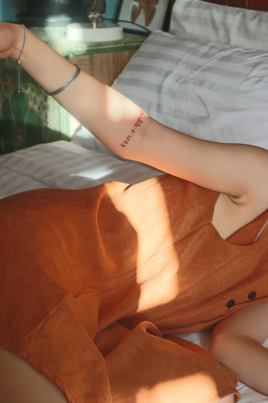 woman in orange sleeveless dress
