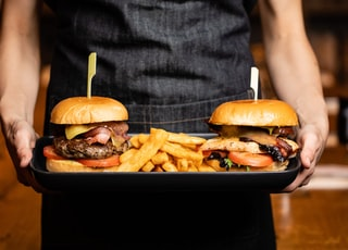 hamburgers and fries on tray