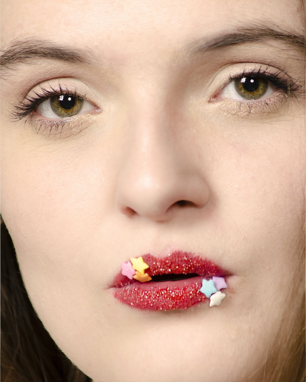 woman with stars on lips