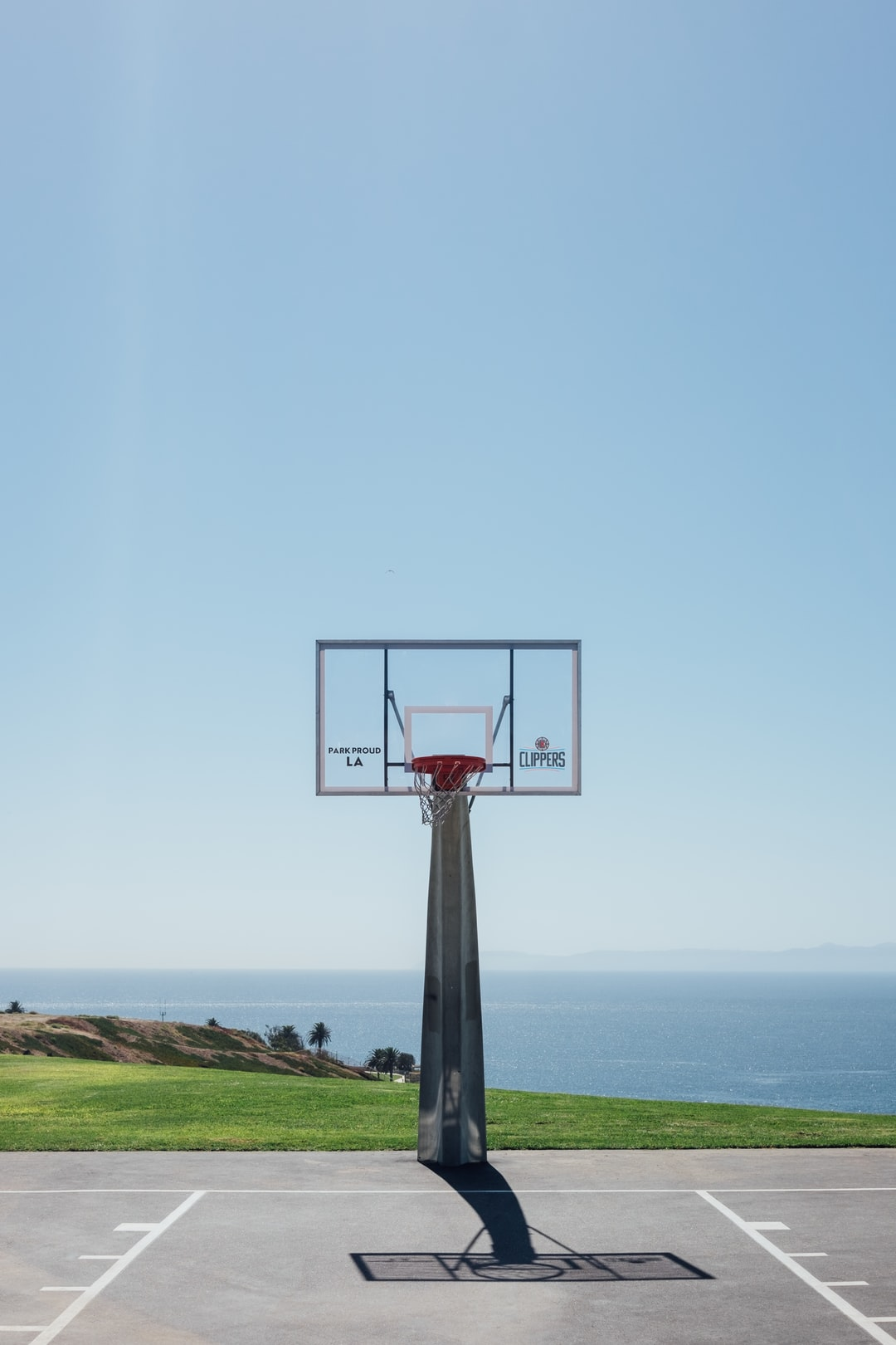 outdoor basketball court near body of water