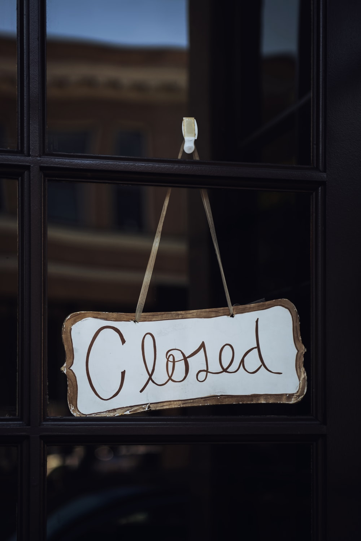 shallow focus photo of white closed signage