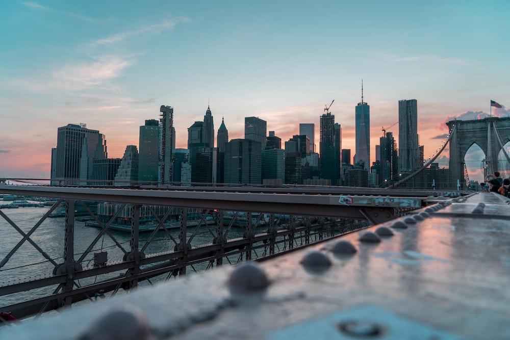 photo of gray building and bridge