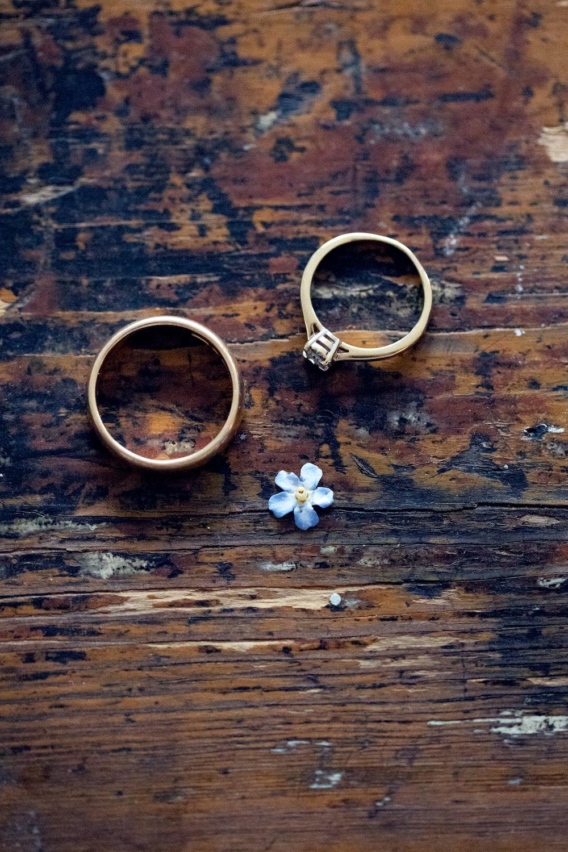 gold-colored bridal ring set