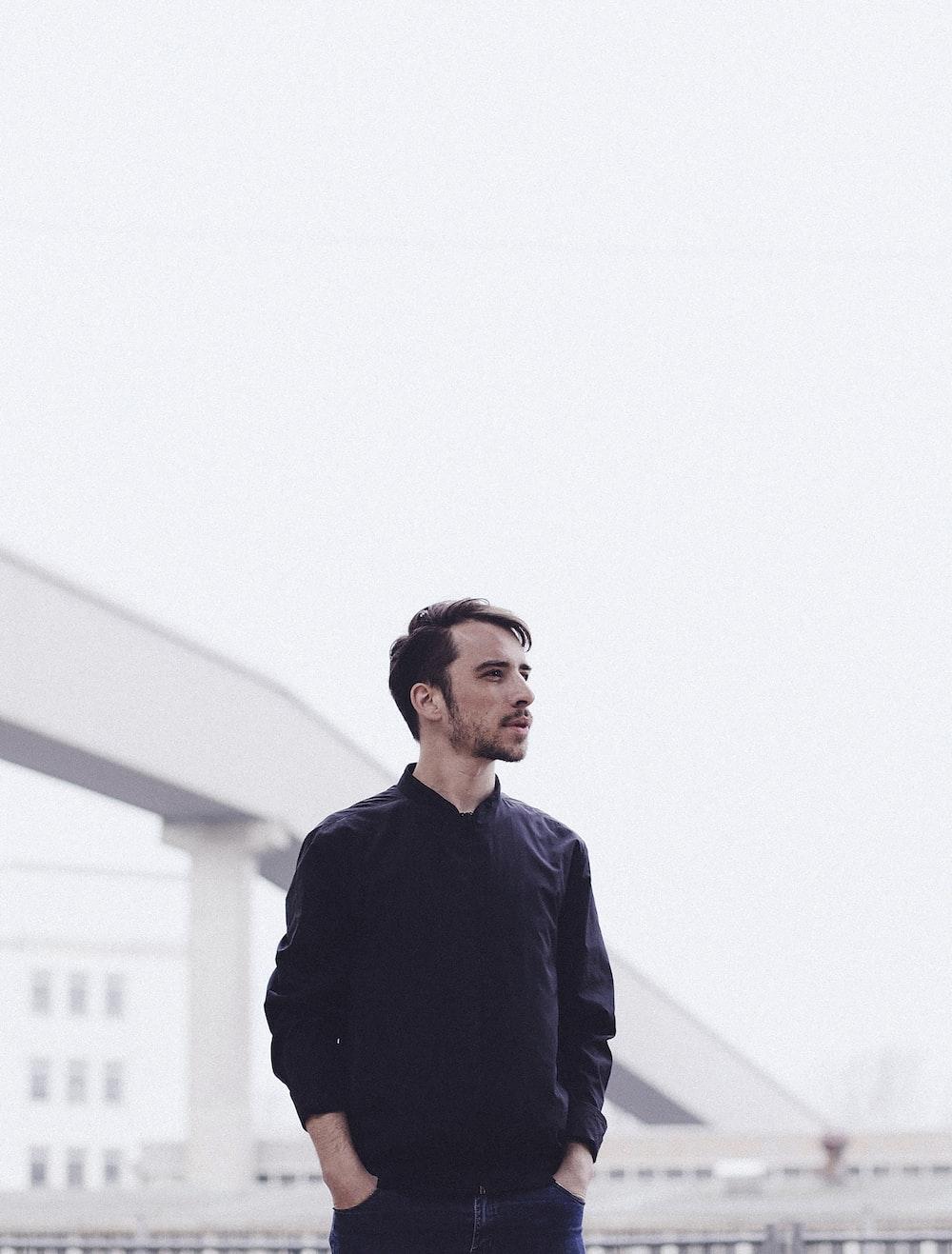 shallow focus photo of man in black dress shirt