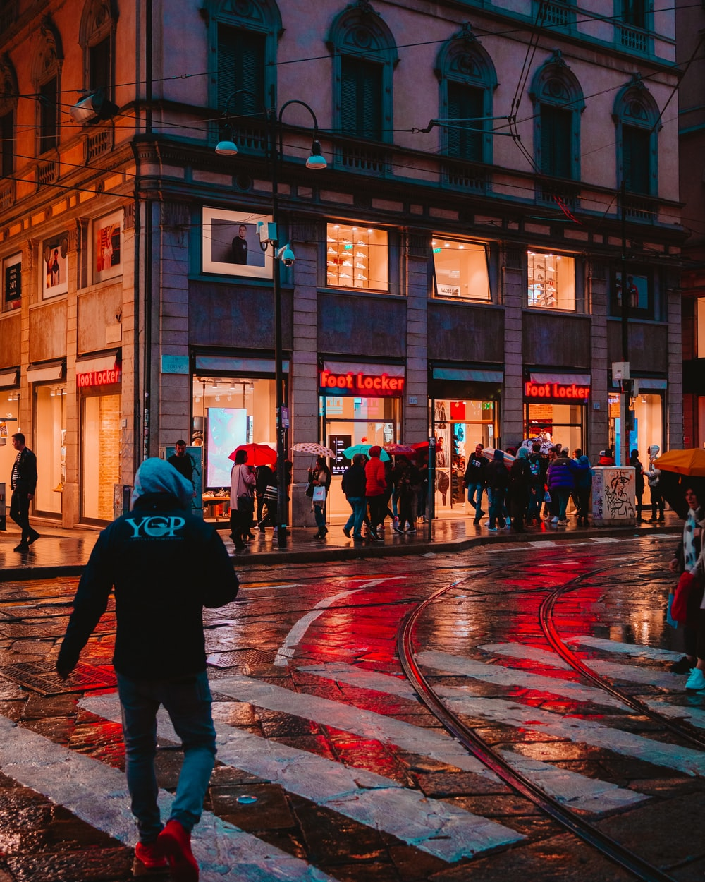 people walk on the street near Foot Locker store