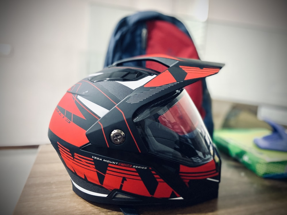 red and black full-face helmet