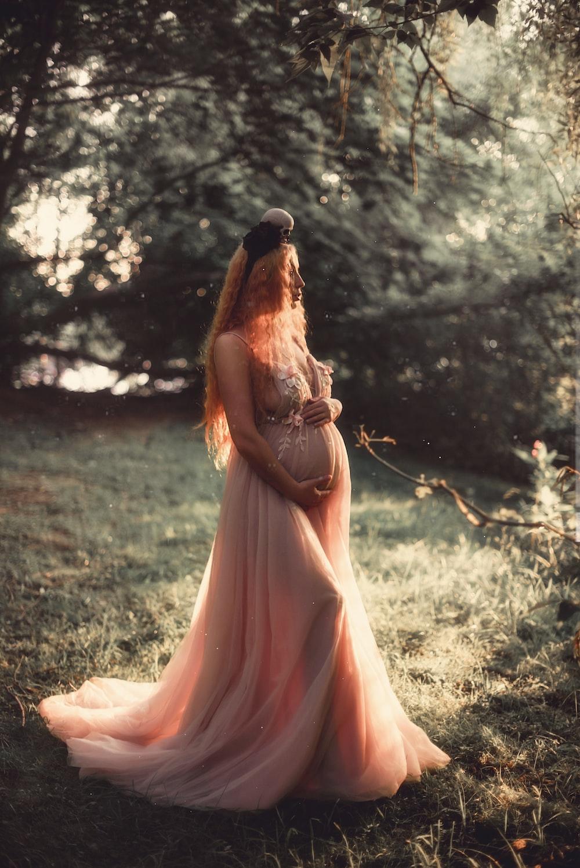pregnant woman near tree