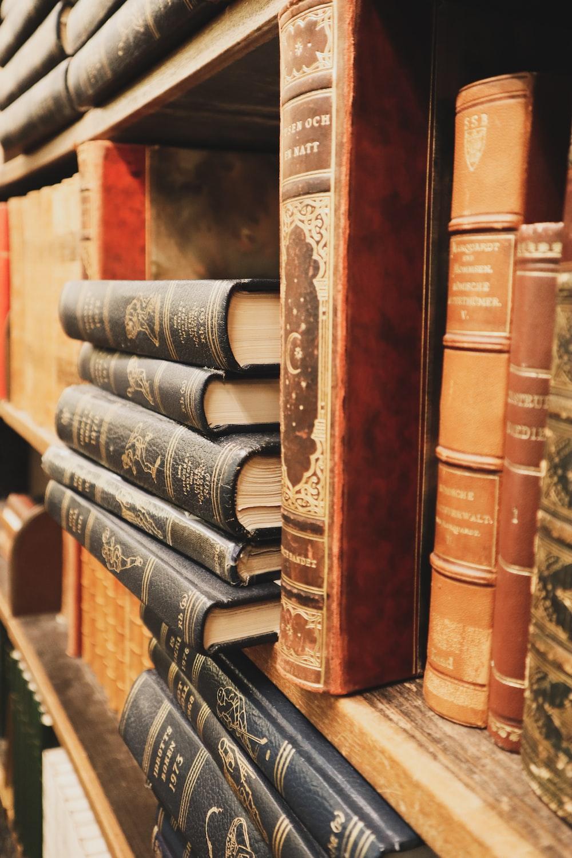 assorted hardbound book lot in shelf