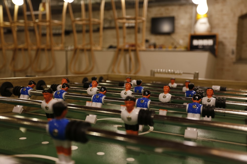 blue, white, and green foosball table
