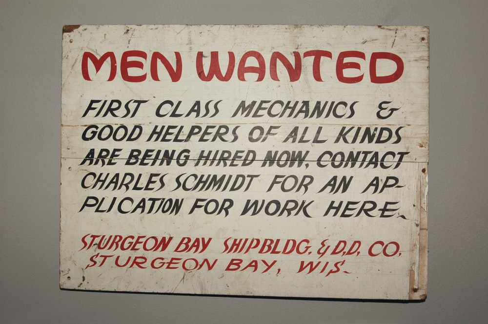 men wanted signage