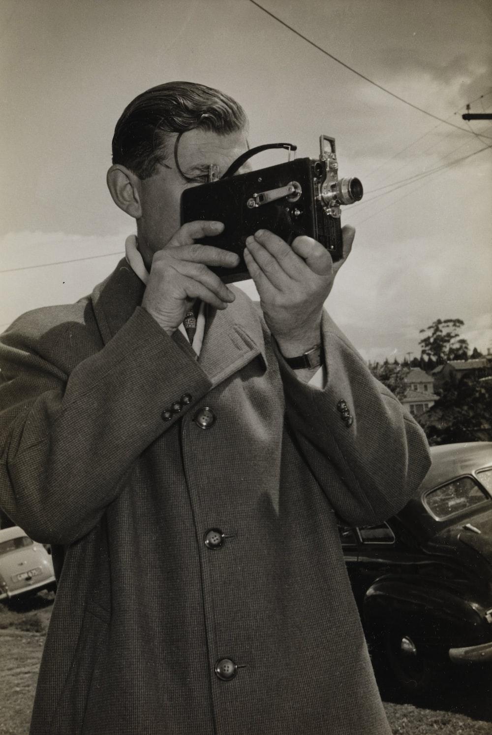 man holding black camera