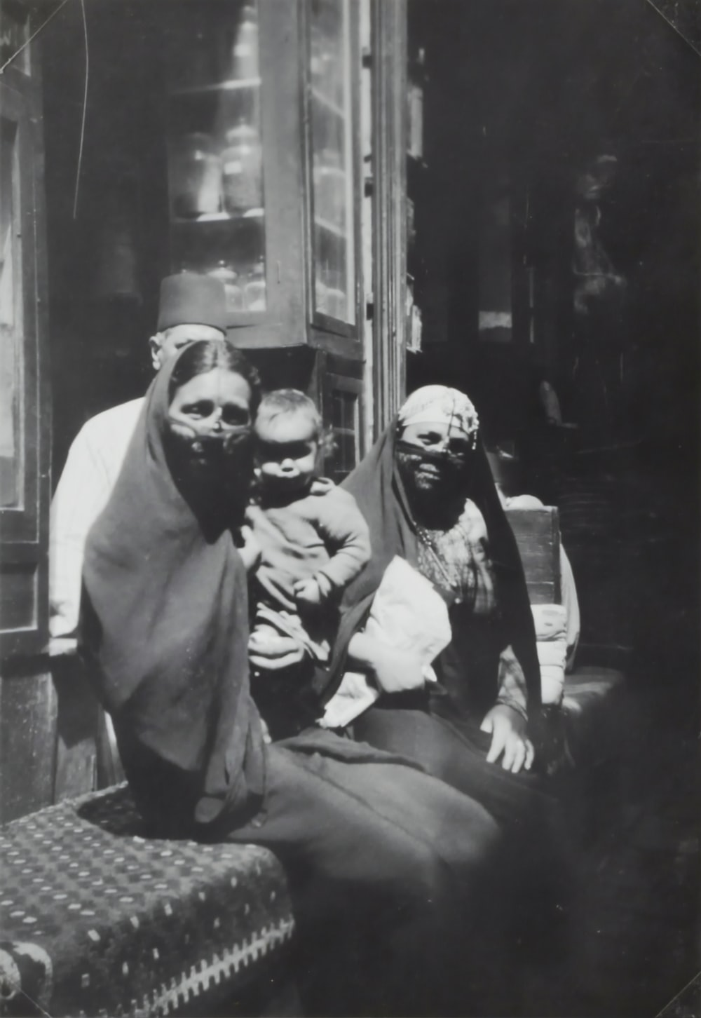 two Egyptian Women sitting on bench