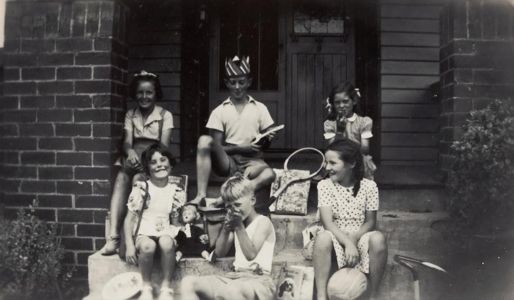 grayscale photo of six children
