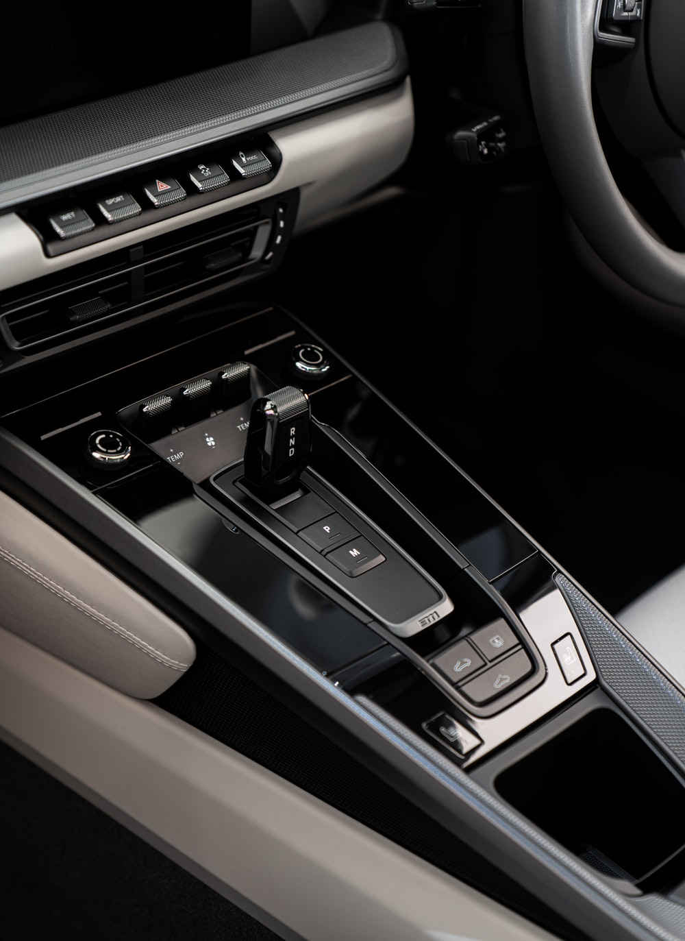 black and grey vehicle gear shift handle