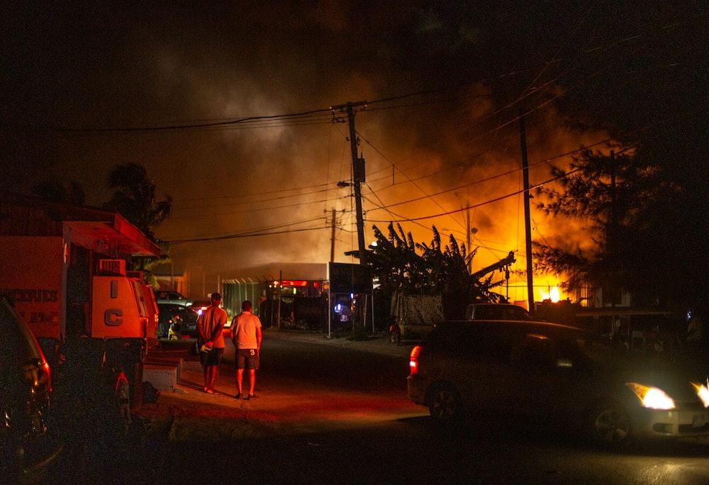 men facing fire