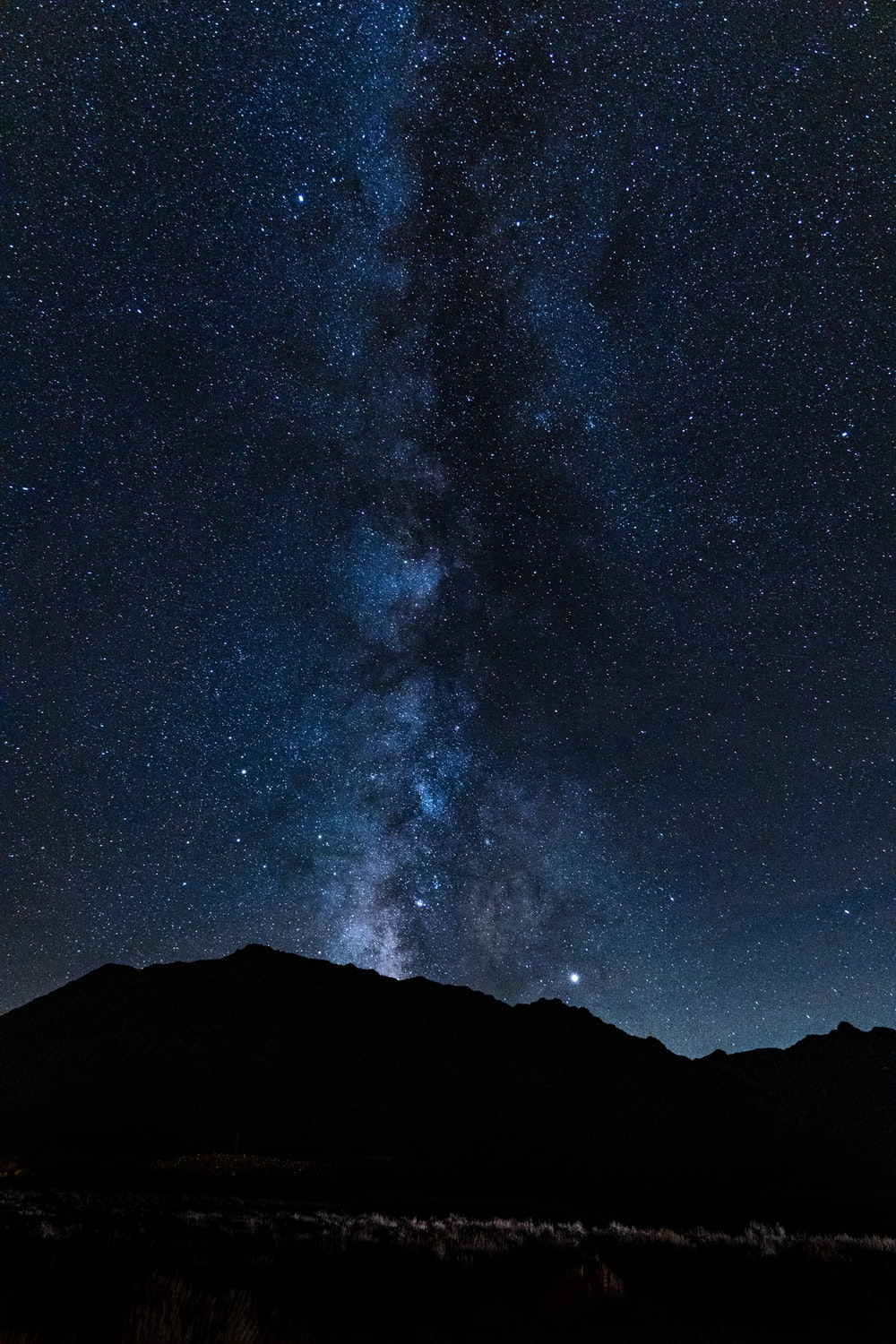 silhouette photography of mountain at night