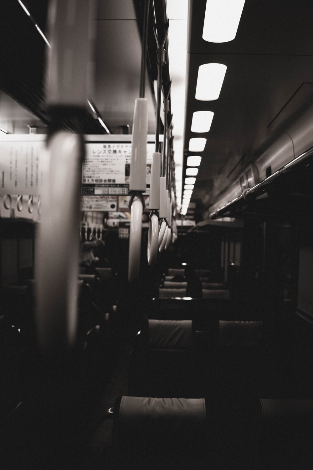 grayscale photography of inside bus view