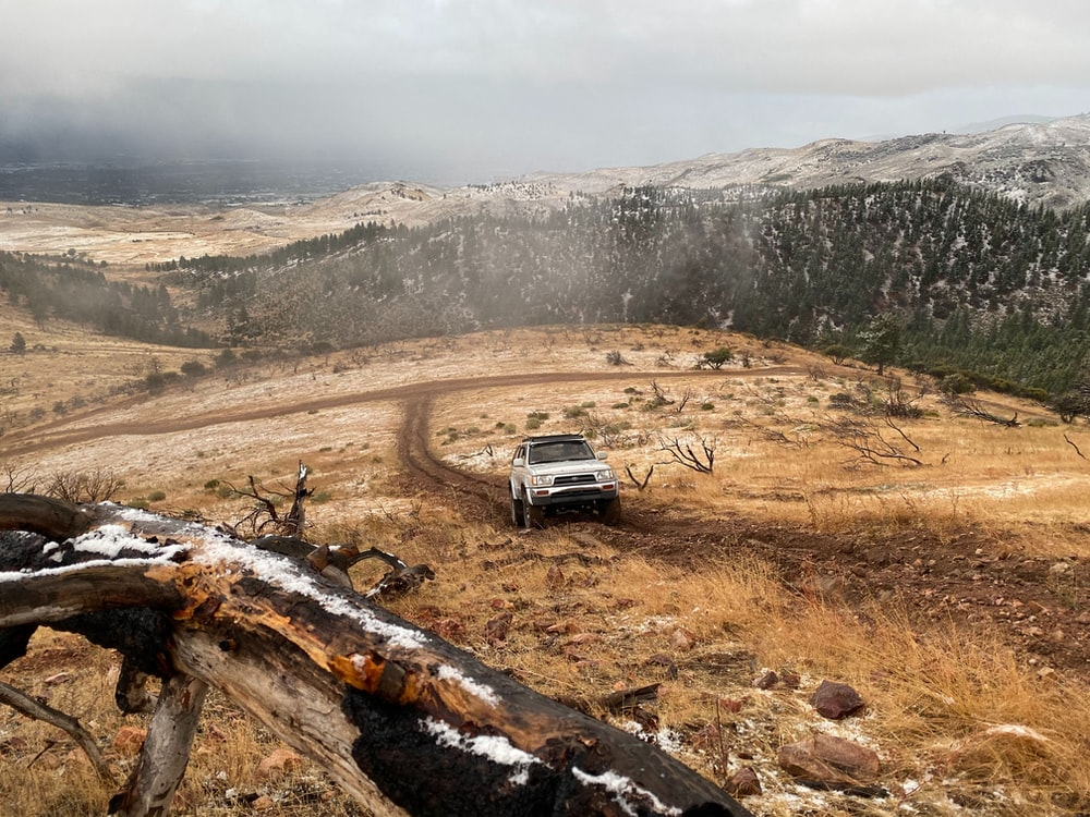 white SUV on muddy road