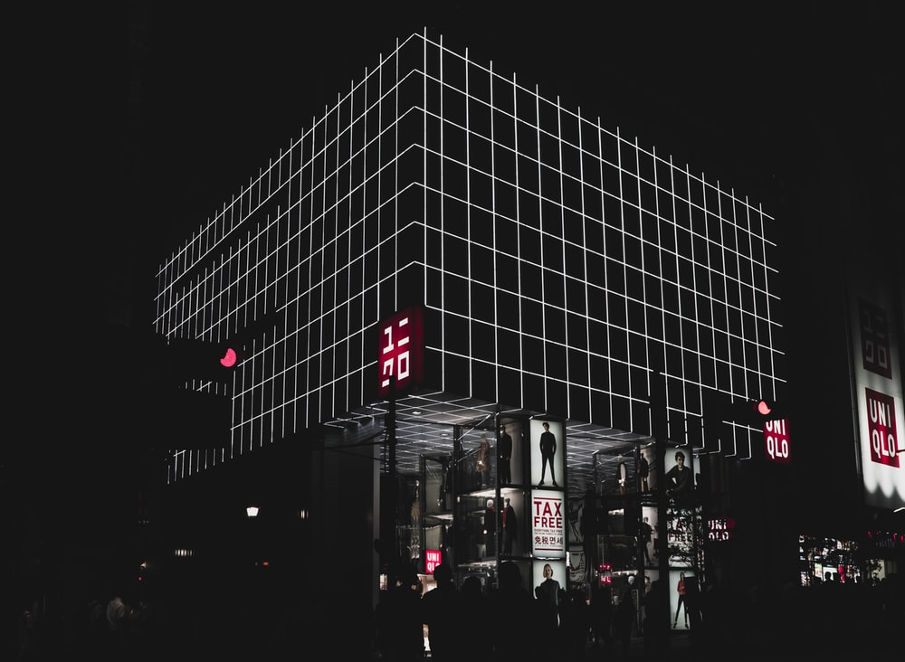 building with billboards at night