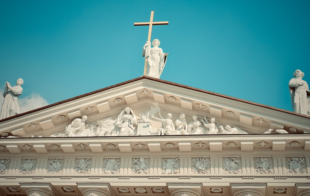 white concrete cathedral statues