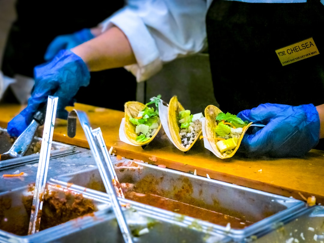 A Wegmans chef prepares tacos during the Grand Opening