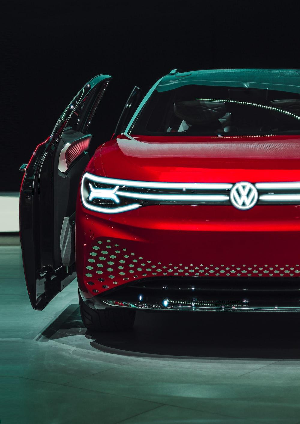 open door of red Volkswagen car