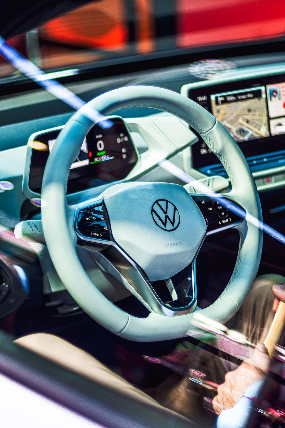 white Volkswagen multi-function steering wheel