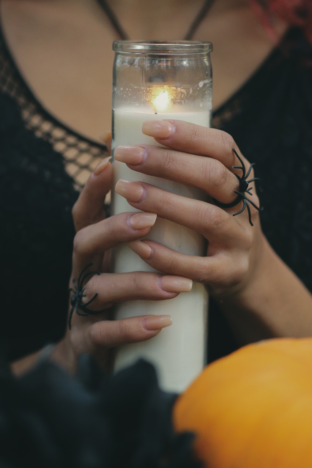 white and black pillar candle