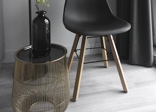 empty chair beside floor lamp