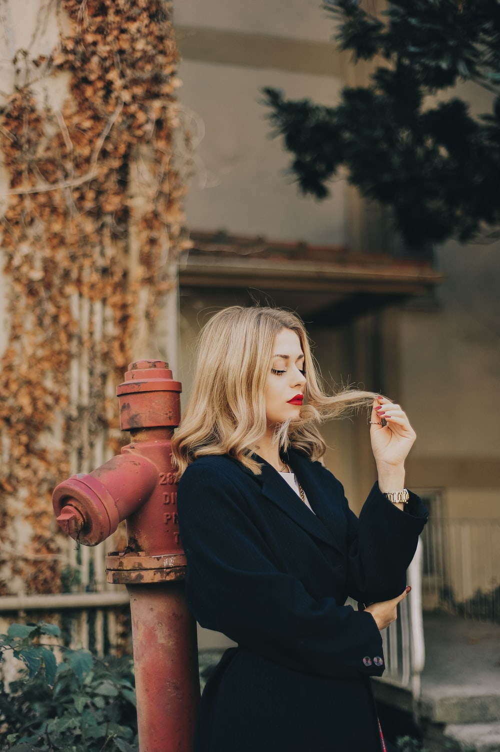 woman leaning on hydrant