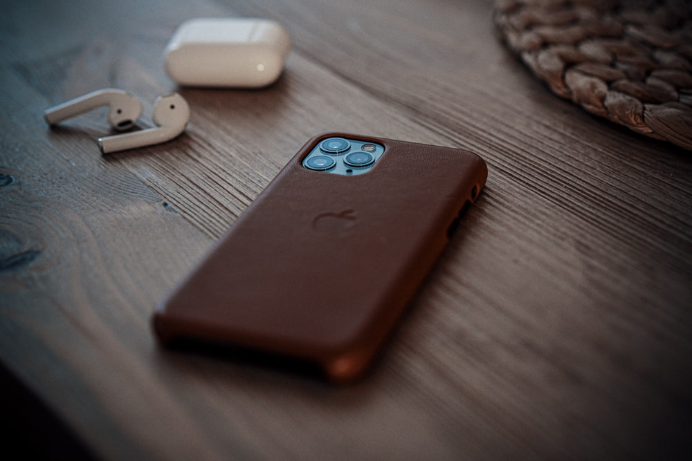 shallow focus photo of iPhone 11 Pro with black case