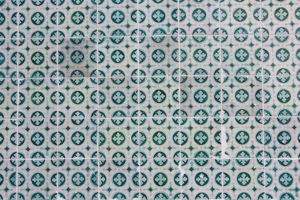 white and green printed textile