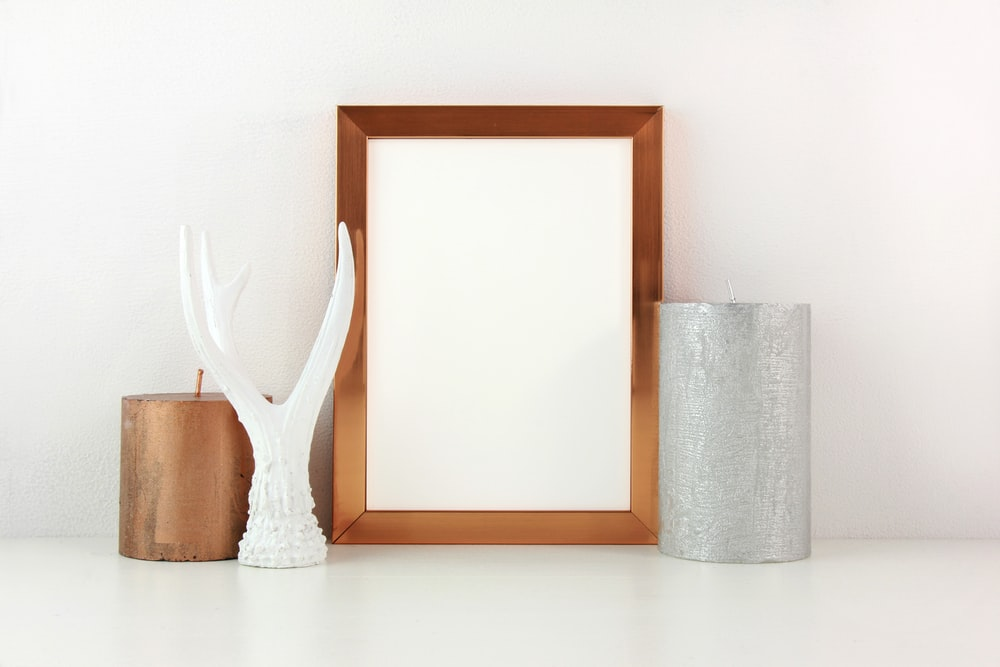 brown wooden framed mirror