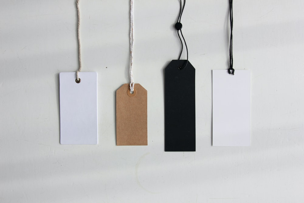 four paper card tags