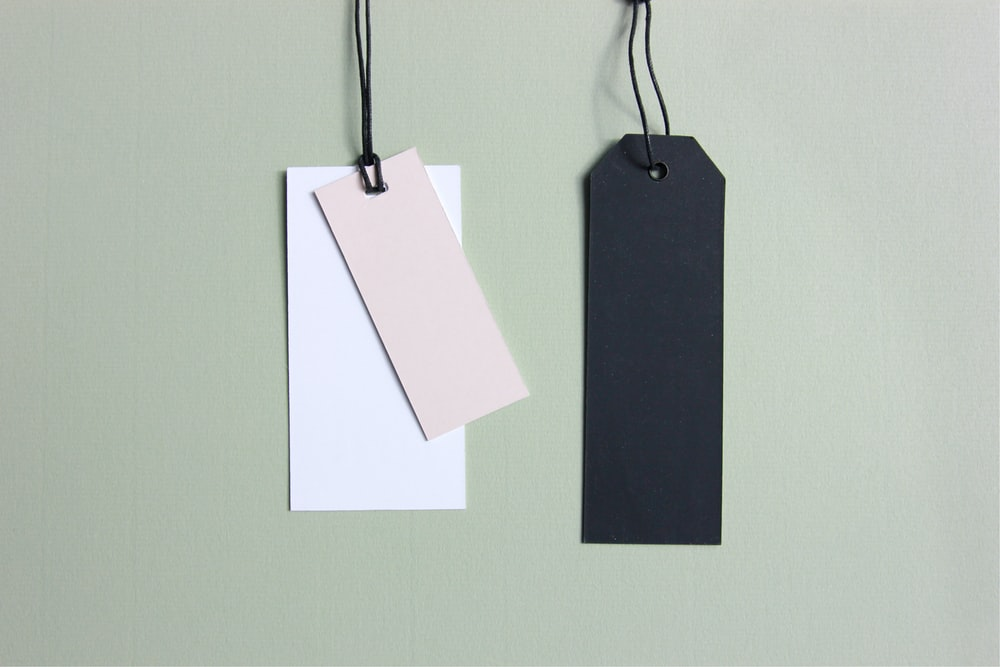 three assorted-color tags