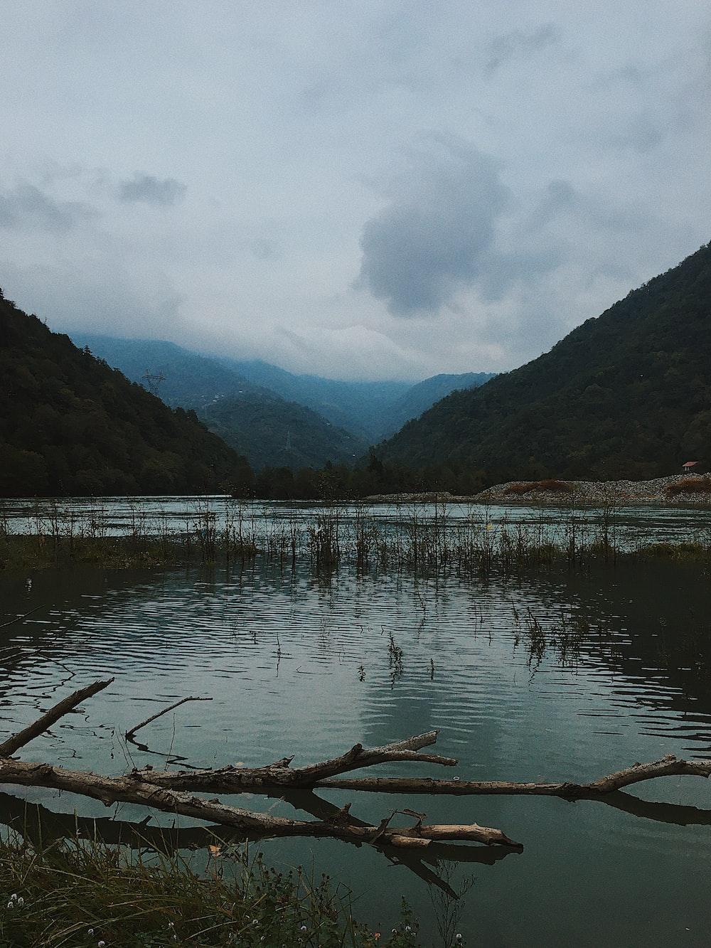 mountain beside calm body of water