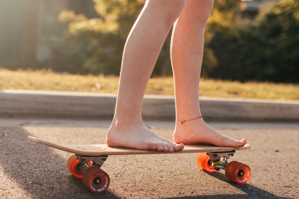 person standing on skateboard during daytime