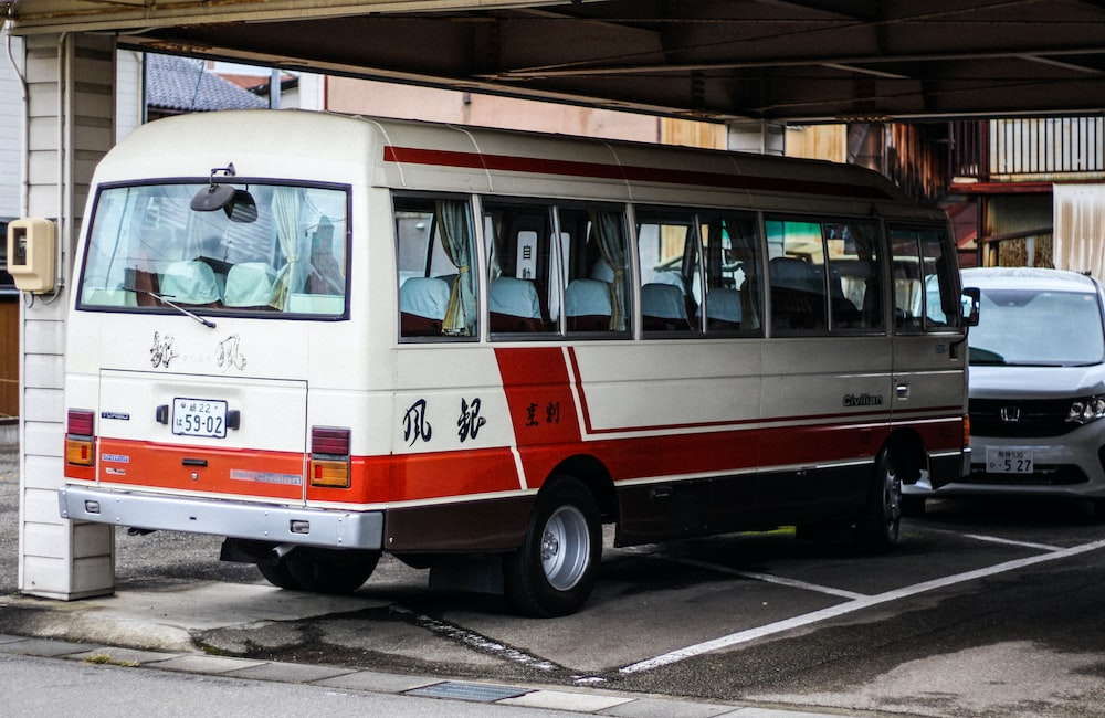 white bus in parking lot
