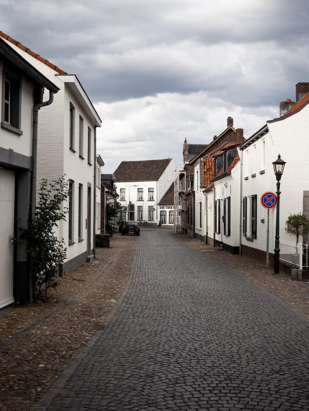 gray concrete road between houses