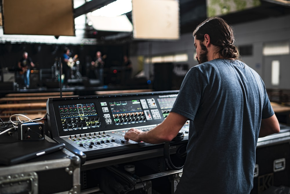 man playing DJ mixer