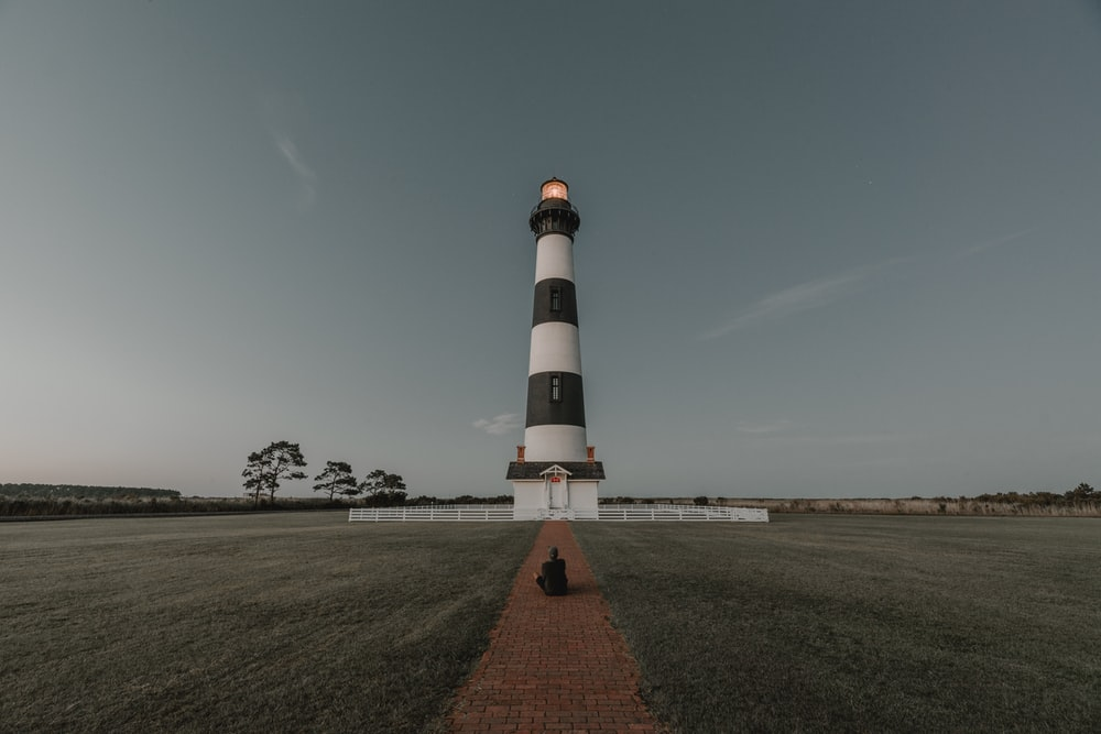 white and black lighthouse miniature