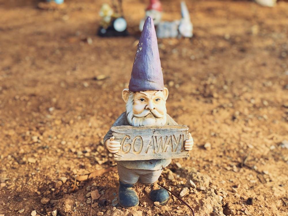 blue and brown ceramic figurine