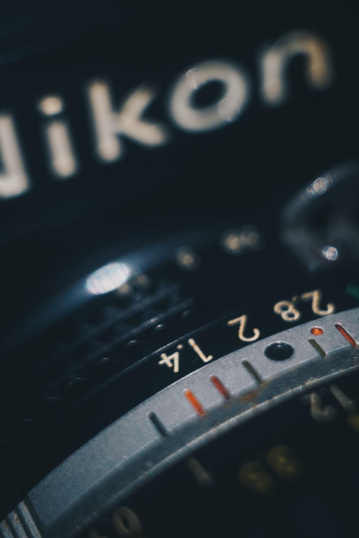 close view of black Nikon camera