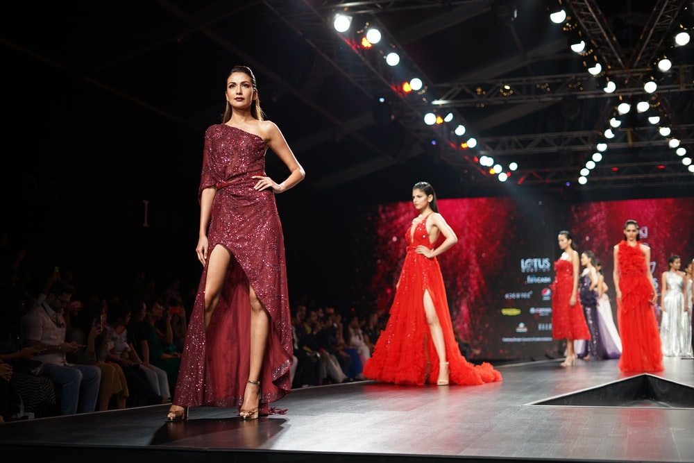 woman wearing maroon one-shoulder slit-side dress