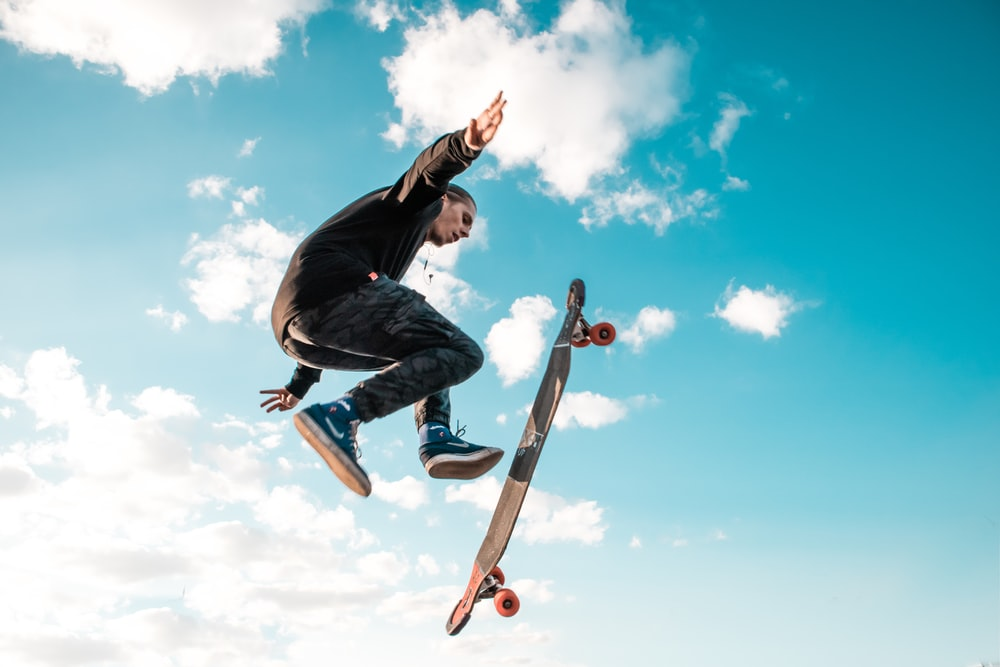 man jump with skateboard