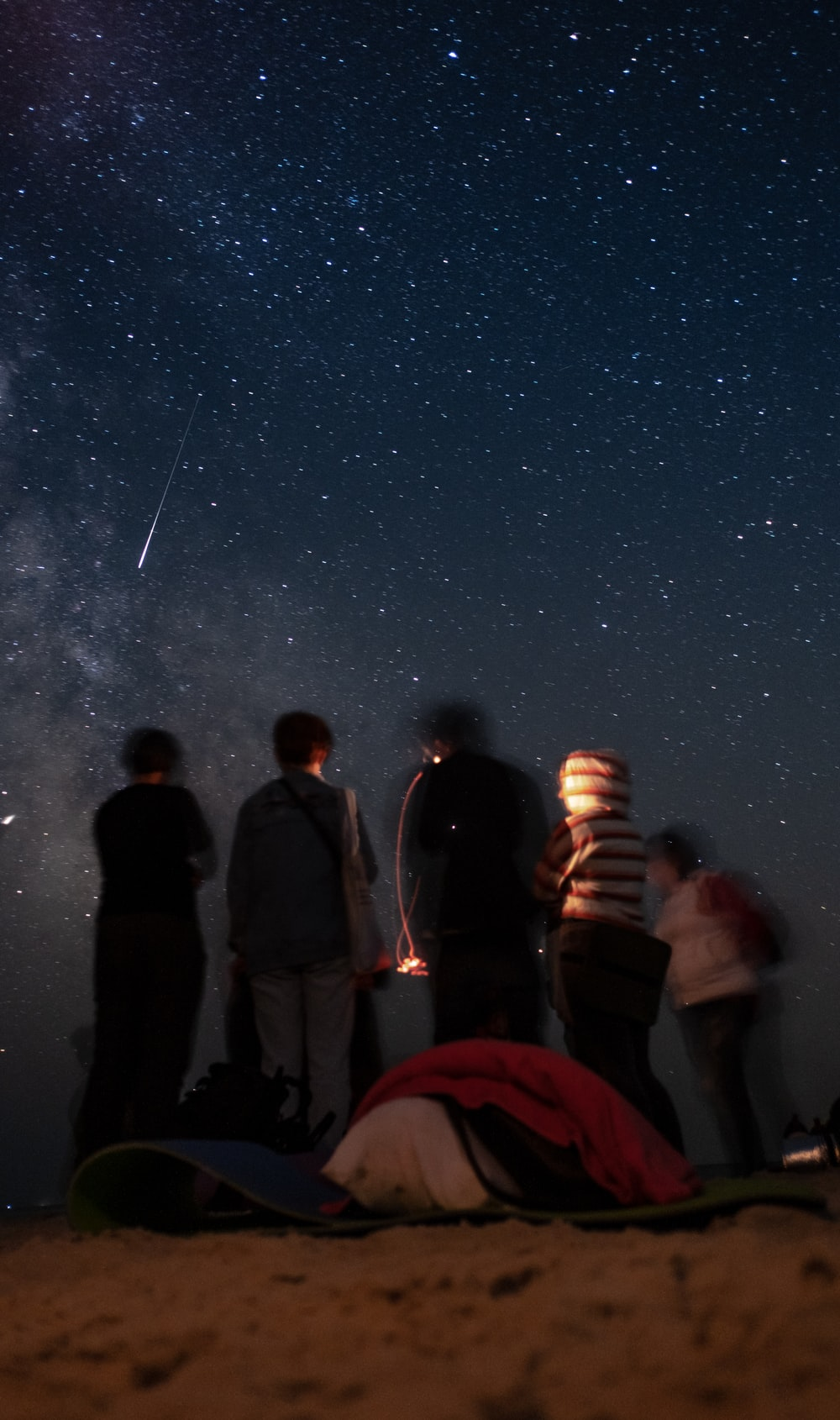 four men standing during nighttime